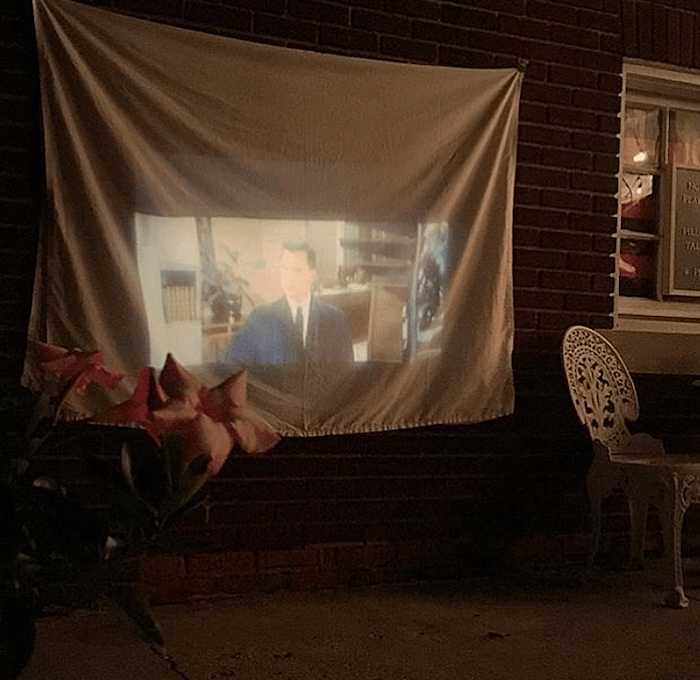 Projected outdoor movie from a Flocktails and Friendship Flamingo Themed Ladies' Night on Kara's Party Ideas | KarasPartyIdeas.com (4)