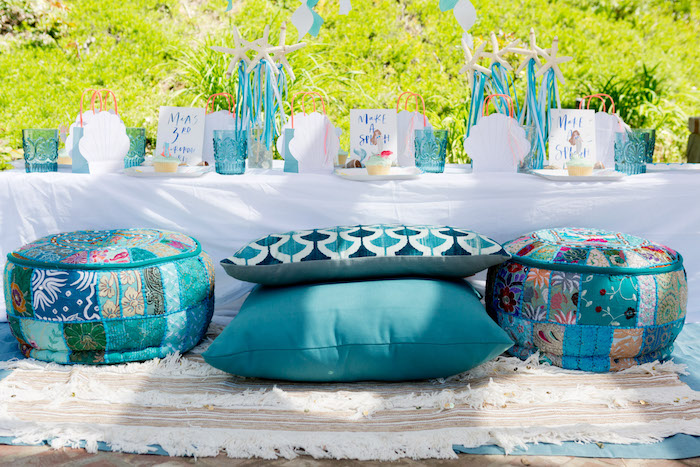 Guest table with pillow seating from a Make a Splash Mermaid Birthday Party on Kara's Party Ideas | KarasPartyIdeas.com (6)