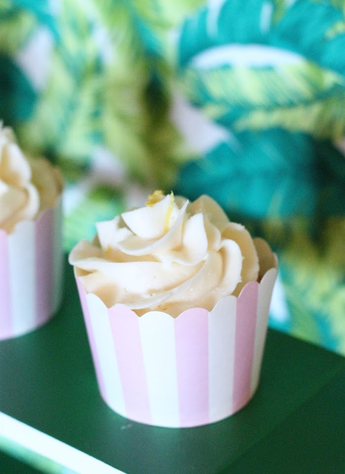 cupcake placed in a pink white striped cup from the beverly hills hotel inspired favorite