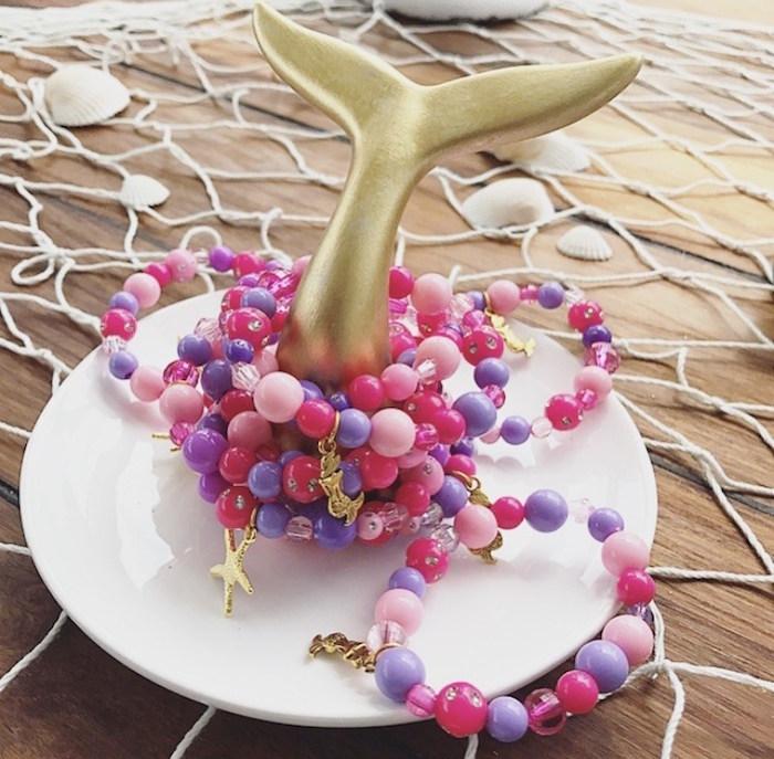 Bracelet favors rung on a mermaid fin from a Seaside Mermaid Birthday Party on Kara's Party Ideas | KarasPartyIdeas.com (12)