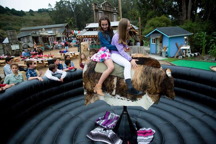 "Mechanical Bull riding from a ""Barn"" Mitzvah - A Barnyard Themed Bat MItzvah on Kara's Party Ideas | KarasPartyIdeas.com (5)"