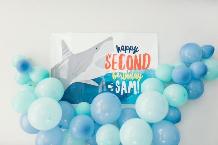 "Shark fin balloon garland + backdrop banner from a ""Chomp"" Shark Themed Birthday Party on Kara's Party Ideas   KarasPartyIdeas.com (28)"