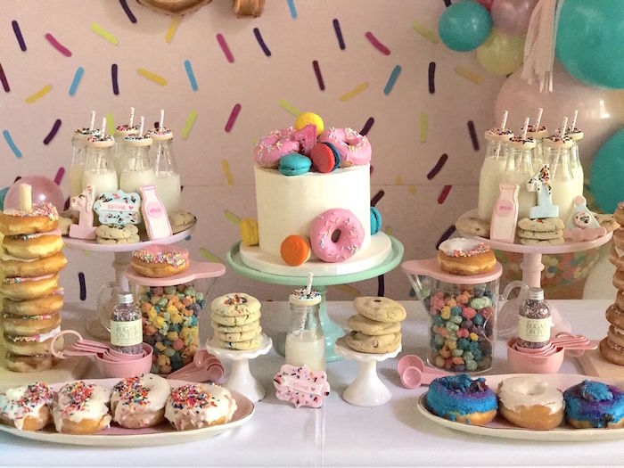 "Donut-inspired dessert table from a ""Donut"" Grow Up 1st Birthday Party on Kara's Party Ideas 