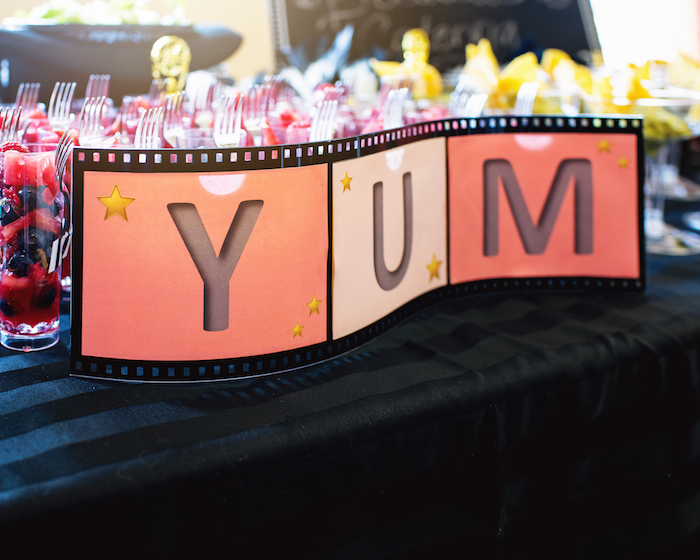 """Yum"" movie reel signage from a Glam Hollywood Birthday Party on Kara's Party Ideas 