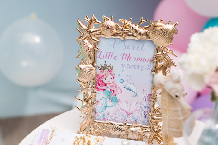 Gold shell frame + mermaid signage from a Pastel Mermaid Birthday Party on Kara's Party Ideas | KarasPartyIdeas.com (24)