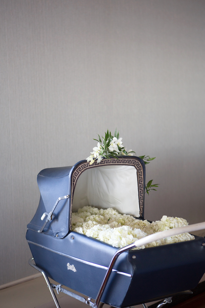 Vintage stroller filled with lush white hydrangeas from a Chic & Shimmery Baby Shower on Kara's Party Ideas | KarasPartyIdeas.com (12)