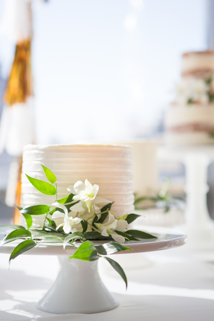 White cake from a Chic & Shimmery Baby Shower on Kara's Party Ideas | KarasPartyIdeas.com (20)