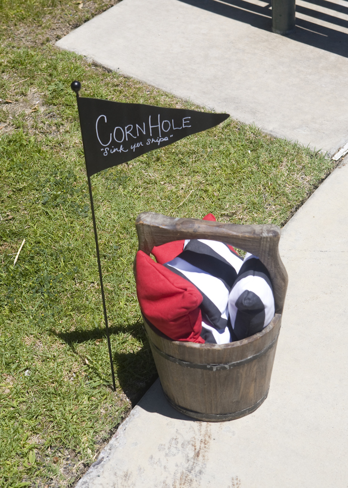 Corn Hole Bucket from a Misty Cove Pirate Birthday Party via Kara's Party Ideas | KarasPartyIdeas.com