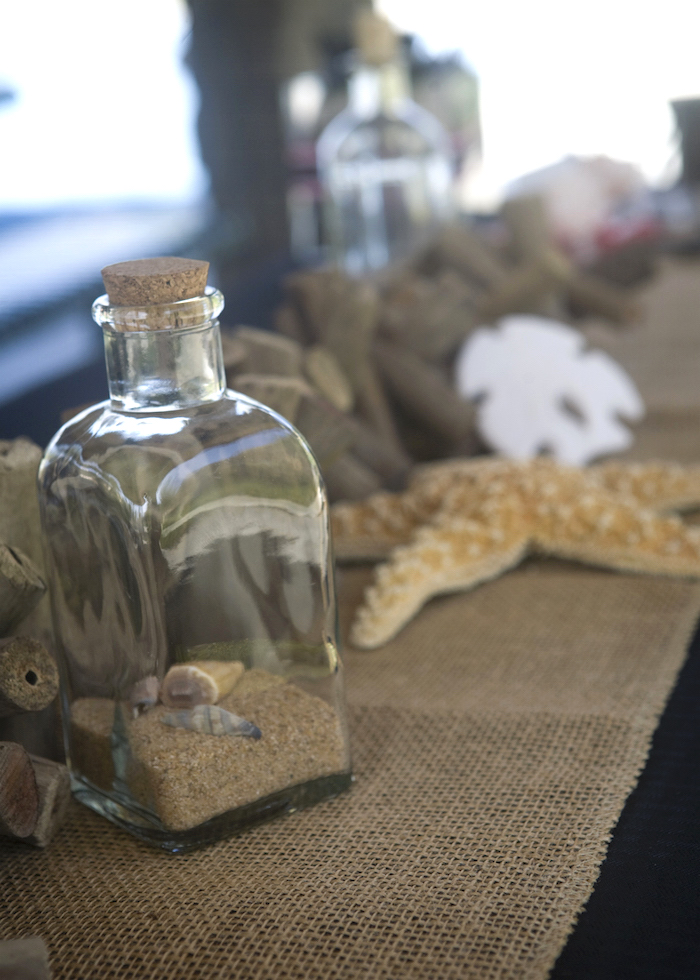 Bottle of sand + decor from a Misty Cove Pirate Birthday Party via Kara's Party Ideas | KarasPartyIdeas.com