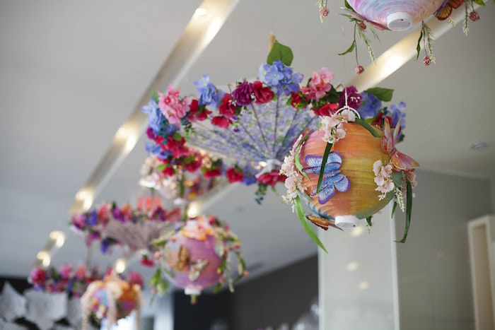 Suspended umbrellas and lanterns adorned with flowers and butterflies from a Garden Tea Party Bridal Shower on Kara's Party Ideas | KarasPartyIdeas.com (20)