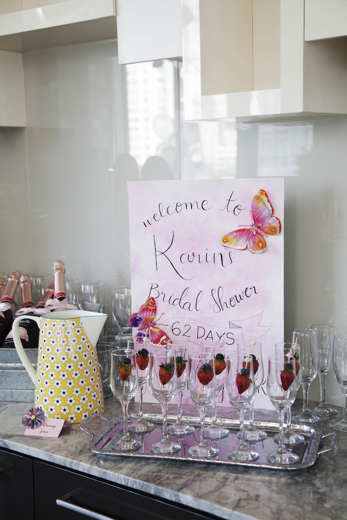 Wine glasses with strawberry stirrers from a Garden Tea Party Bridal Shower on Kara's Party Ideas | KarasPartyIdeas.com (15)