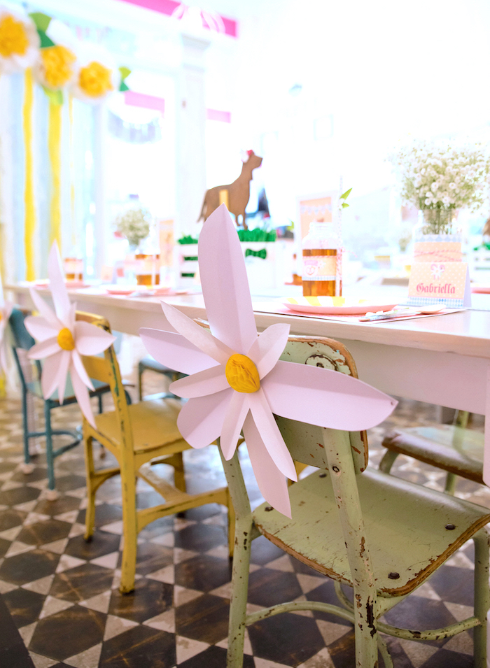 Rustic guest chairs adorned with paper edelweiss flowers from a Girly Oktoberfest Party on Kara's Party Ideas | KarasPartyIdeas.com (11)