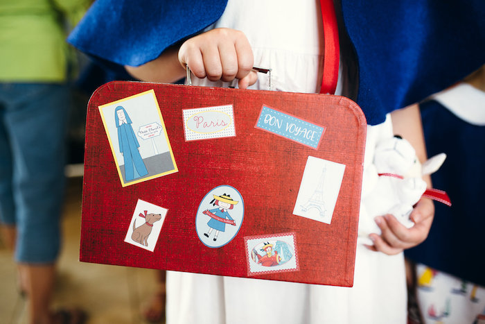 Vintage suitcase adorned with stickers from a Madeline in Paris Birthday Party on Kara's Party Ideas | KarasPartyIdeas.com (14)