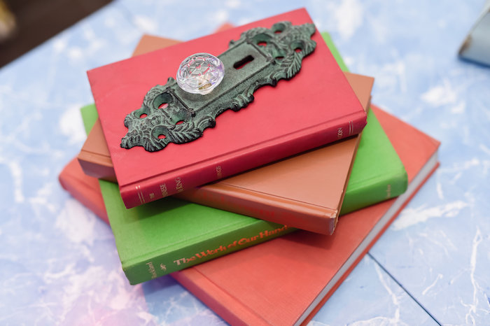 Stacked book and door knob centerpiece from a Modern Alice in Wonderland Birthday Party on Kara's Party Ideas | KarasPartyIdeas.com (11)