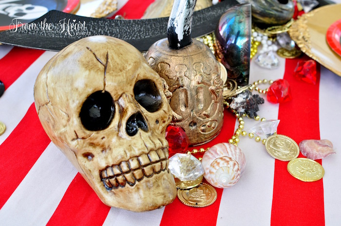 Pirate skull and loot + guest table decor from a Neverland Birthday Party on Kara's Party Ideas | KarasPartyIdeas.com (48)