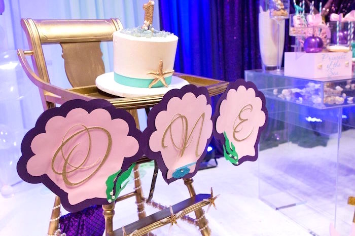 "Shell banner & smash cake from a ""Princess of the Sea"" Birthday Party on Kara's Party Ideas 