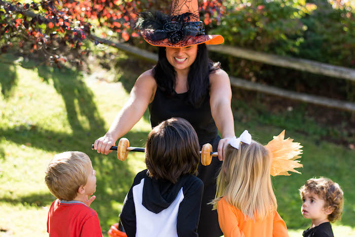 """Doughnuts on a stick from a """"Witches, Boos, & Spiders Too"""" Halloween Party for Kids on Kara's Party Ideas 