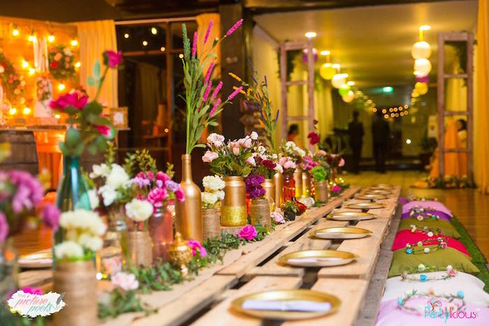 Guest table center lined with gold painted bottles + flower vases from a Bohemian Coachella Birthday Party on Kara's Party Ideas | KarasPartyIdeas.com (34)