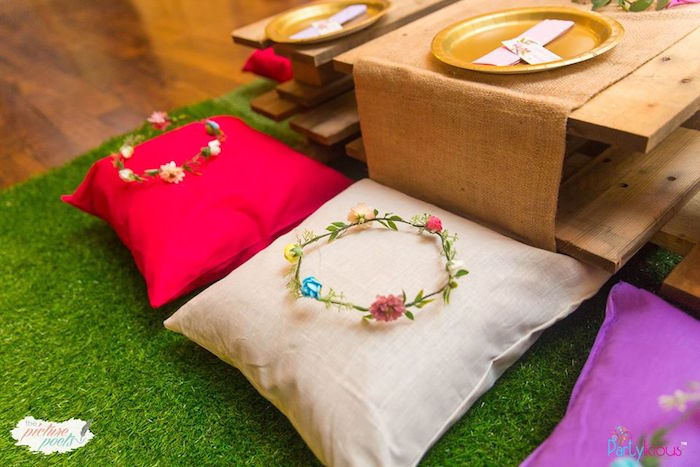 Pillow seating adorned with floral crowns from a Bohemian Coachella Birthday Party on Kara's Party Ideas | KarasPartyIdeas.com (49)