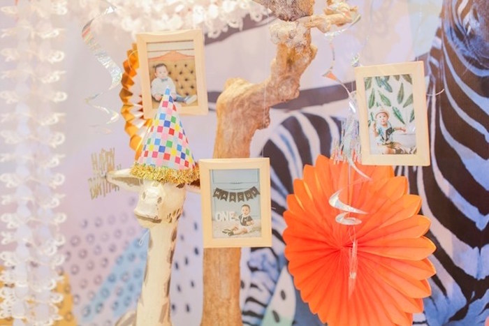 Hanging photo frames + decor from a Party Animal + Zoo Themed Birthday Party on Kara's Party Ideas | KarasPartyIdeas.com (20)
