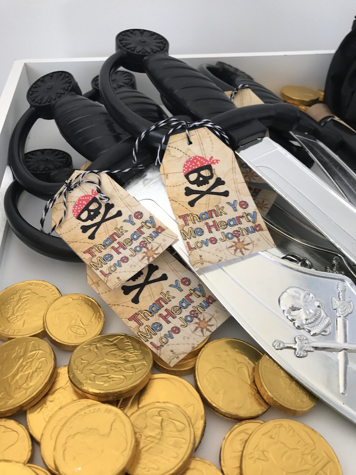 Pirate swords and gold coins from a Pirate Birthday Party on Kara's Party Ideas | KarasPartyIdeas.com (19)