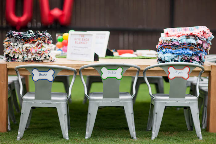 Blanket tying table from a Puppy PAW-ty on Kara's Party Ideas | KarasPartyIdeas.com (7)