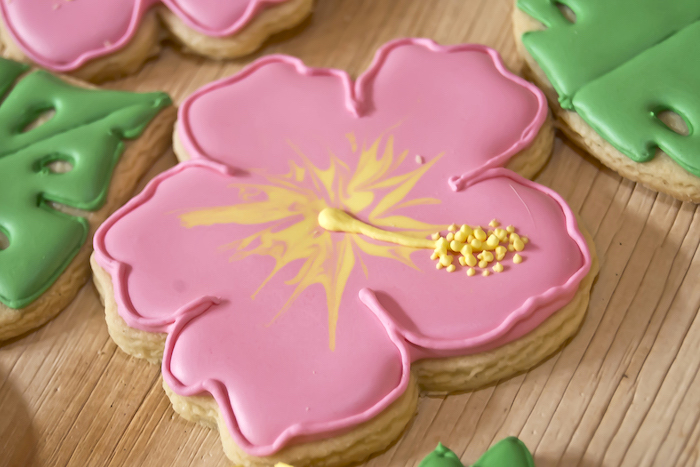 Hibiscus flower cookie from a Tropical Toucan Birthday Party on Kara's Party Ideas | KarasPartyIdeas.com (5)