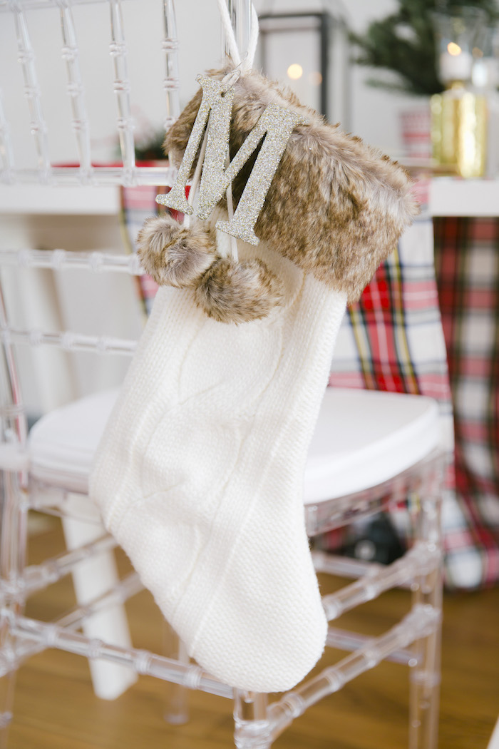 "Stocking-adorned chair back from a ""Let it Snow"" Christmas Party on Kara's Party Ideas 