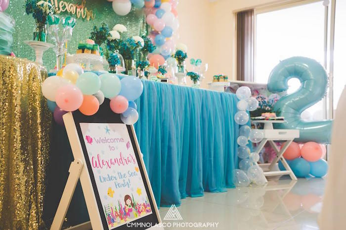 Signage and table skirt from a Glamorous Under the Sea Birthday Party on Kara's Party Ideas | KarasPartyIdeas.com (15)