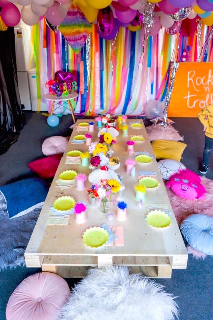 Pallet guest table with pillow seating from a Rainbow Trolls Disco Birthday Party on Kara's Party Ideas | KarasPartyIdeas.com (20)