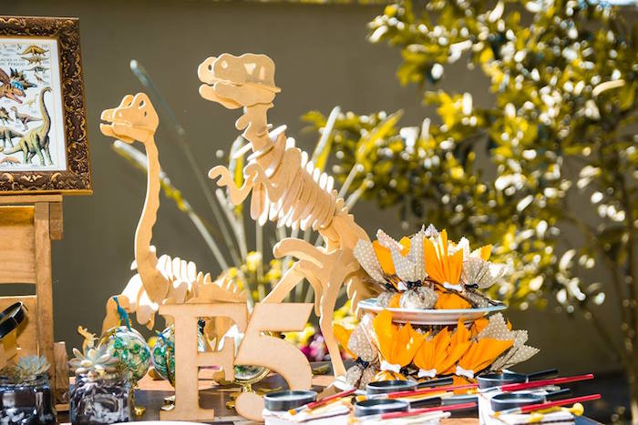 Cardboard skeletons from a Rustic Dinosaur Birthday Party on Kara's Party Ideas | KarasPartyIdeas.com (5)