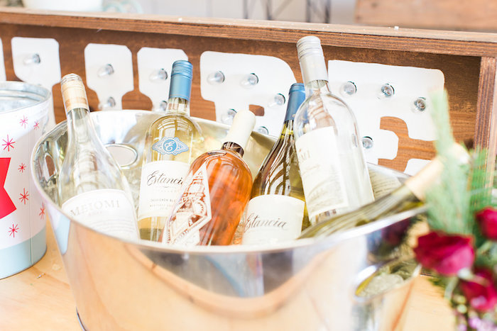 Wine bottles from a Holiday Boho Baby Shower on Kara's Party Ideas | KarasPartyIdeas.com (5)