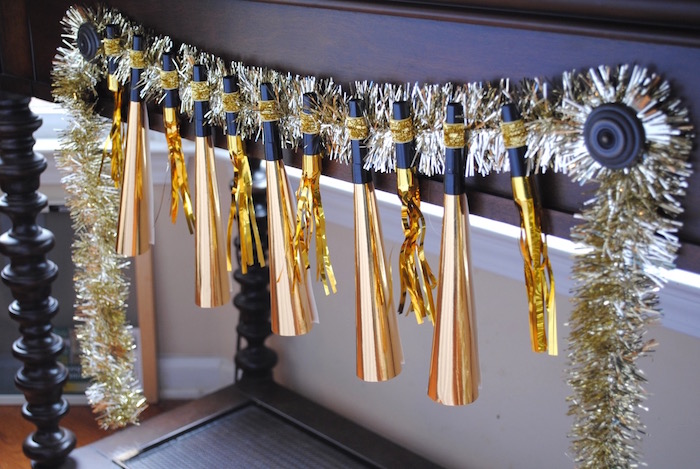 Noisemaker Garland from a NYE Movie Night on Kara's Party Ideas | KarasPartyIdeas.com