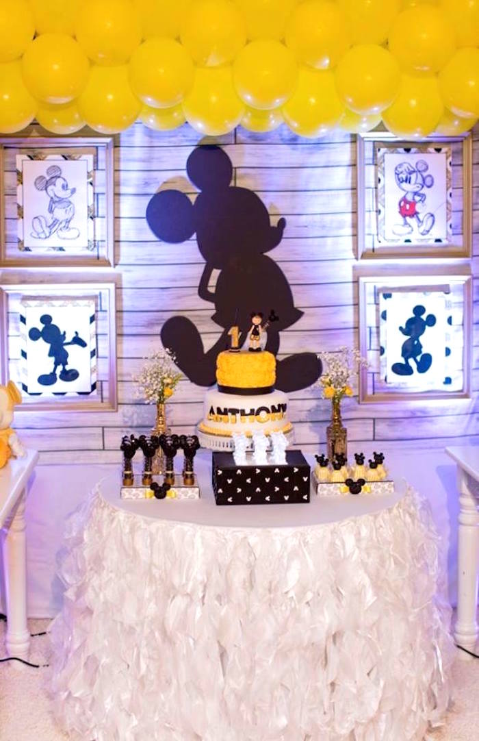 Cake table from a Yellow & Gold Mickey Mouse Birthday Party on Kara's Party Ideas | KarasPartyIdeas.com (10)