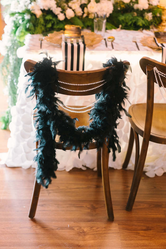 Guest chair adorned with pearls + feather boa from a 1920's Gangster Inspired Birthday Party on Kara's Party Ideas | KarasPartyIdeas.com (4)