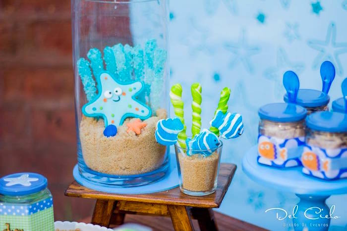 "Lollipops in brown sugar ""sand"" from a Baby Sea Animal Birthday Party on Kara's Party Ideas 
