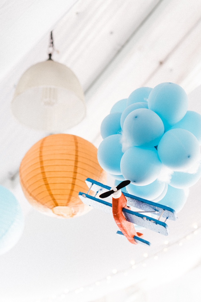 Hanging lanterns, balloon bunches and airplane from a Planes, Trains, Automobiles Transportation Party on Kara's Party Ideas | KarasPartyIdeas.com (23)