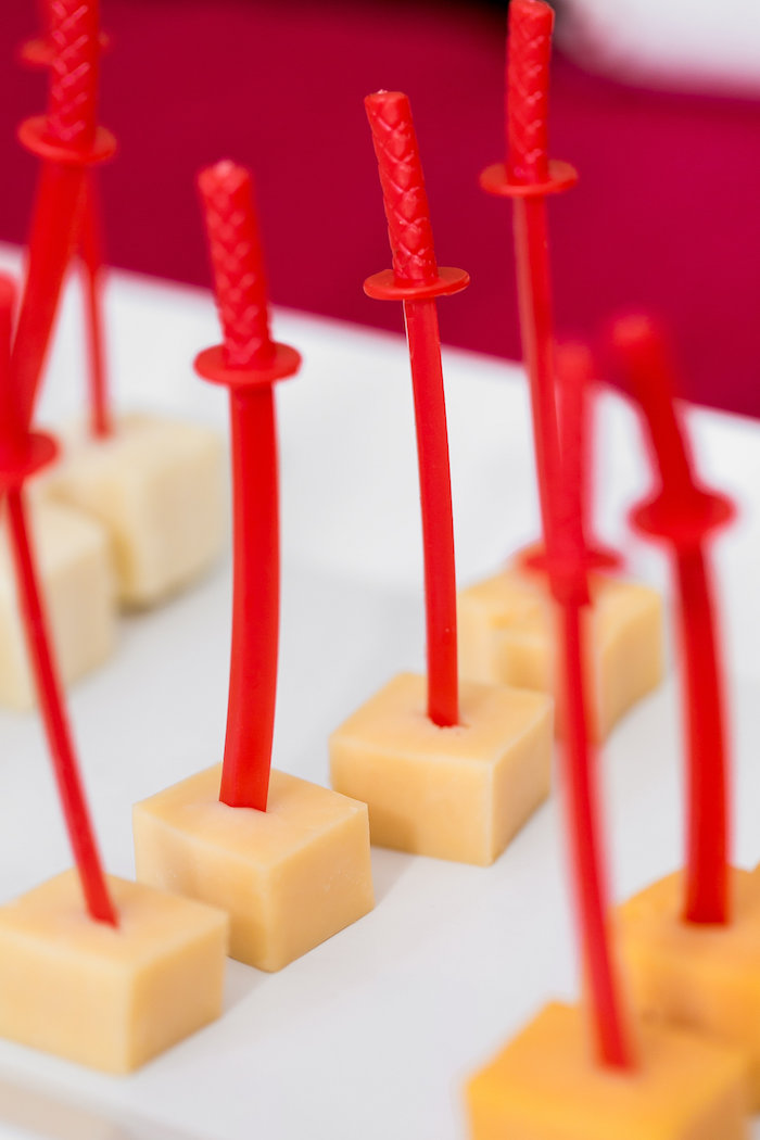 Ninja Sword-skewered cheese blocks from a Red, White & Black Ninja Birthday Party on Kara's Party Ideas | KarasPartyIdeas.com (14)