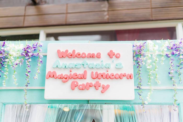 Floral adorned arch from a Pastel Unicorn Birthday Party on Kara's Party Ideas | KarasPartyIdeas.com (11)