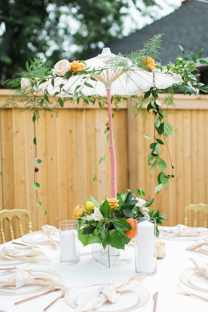 garden guest table with umbrella centerpiece from an umbrella bridal shower on karas party ideas