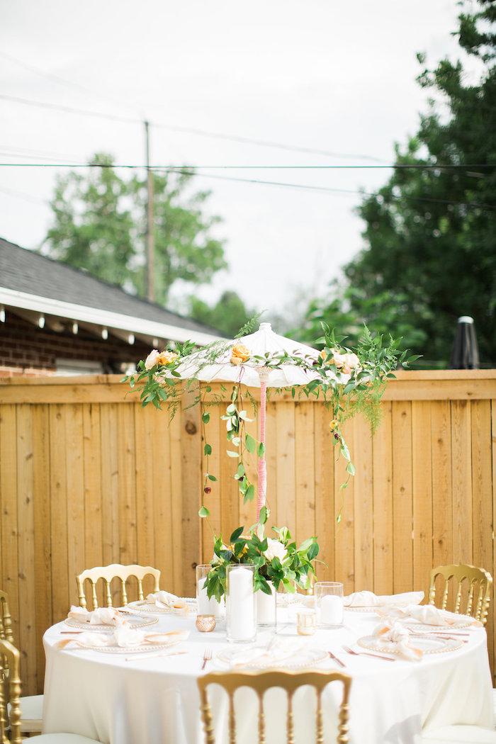 garden guest table with umbrella centerpiececanopy from an umbrella bridal shower on karas party