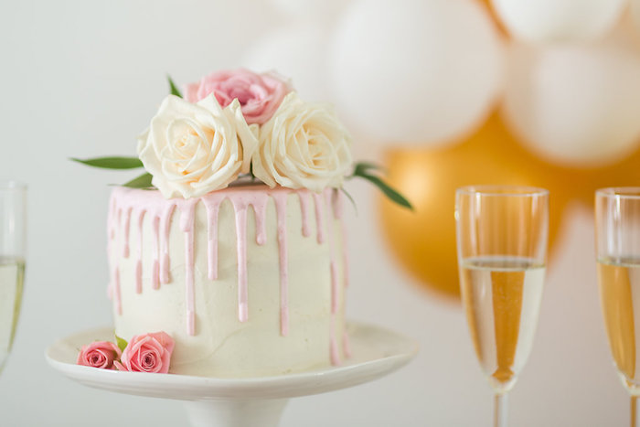 floral drip cake from a champagne brunch bridal shower on karas party ideas karaspartyideas