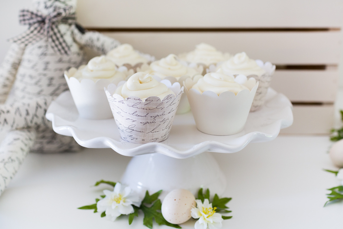 White Cupcakes in DIY Cupcake Wrappers from a Monochromatic Easter Party via Kara's Party Ideas | KarasPartyIdeas.com