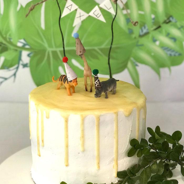 Safari Animal Drip Cake from a Wild & Free Jungle Birthday Party on Kara's Party Ideas | KarasPartyIdeas.com (10)