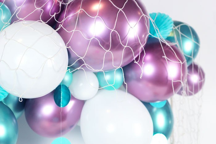 "Netted Balloon Banner from a ""Wish We Were Mermaids"" Birthday Party on Kara's Party Ideas 