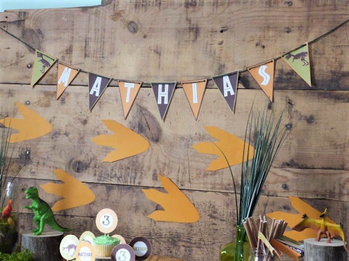Dinosaur Track Backdrop from a Rustic Dinosaur Birthday Party on Kara's Party Ideas | KarasPartyIdeas.com