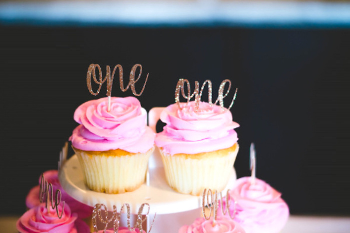 Pink-iced Cupcakes with Gold Glitter Toppers from a Floral First Birthday Party on Kara's Party Ideas | KarasPartyIdeas.com (18)