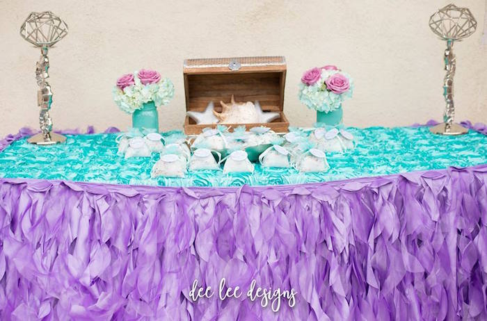 under the sea themed favor table from a mermaid under the sea bridal shower on