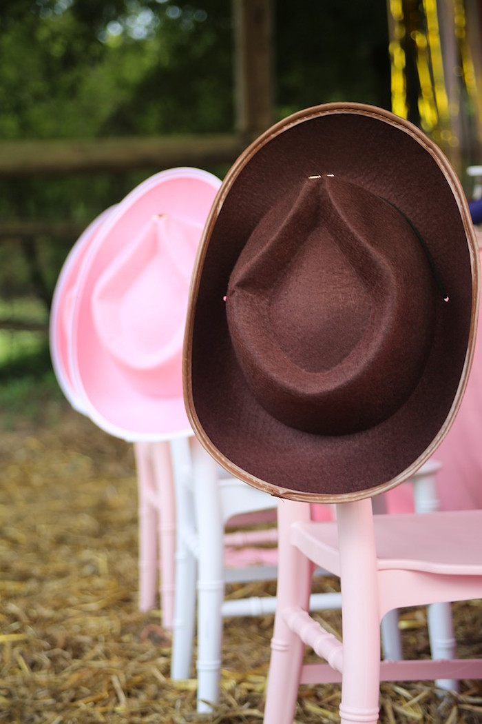 Pink Chairs adorned with Cowgirl Hats from a Pink Pony Birthday Party on Kara's Party Ideas | KarasPartyIdeas.com (6)