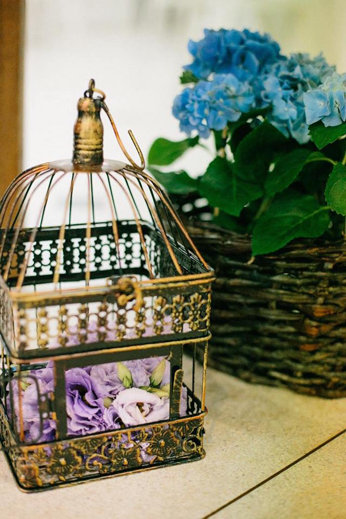Bird cage filled with blooms from a Butterfly Garden Baptism Party on Kara's Party Ideas | KarasPartyIdeas.com (8)
